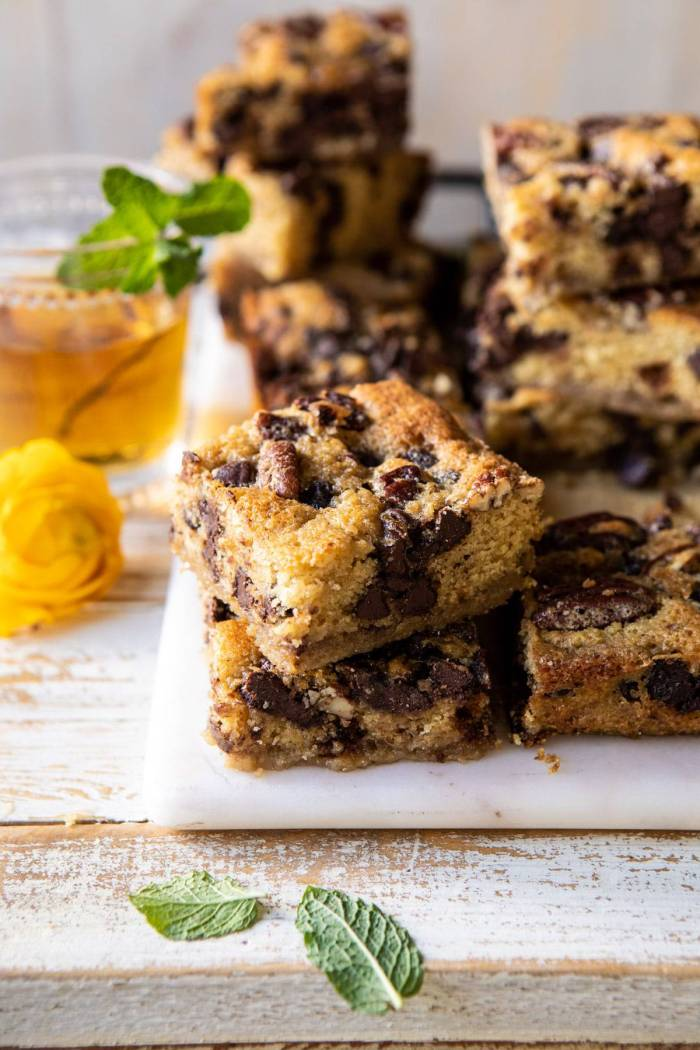 side angled of Kentucky Derby Pie Chocolate Chip Cookie Bars stacked on top of each other