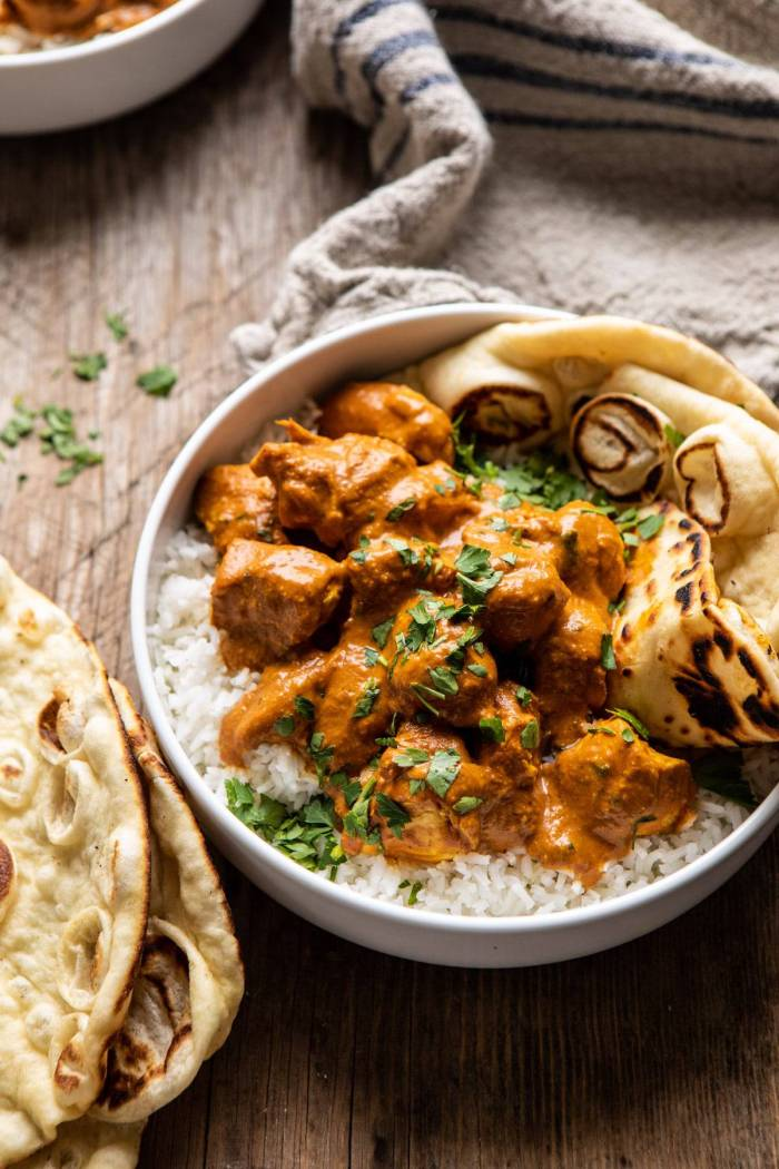 side angled photo of Super Simple Coconut Chicken Tikka Masala in bowl with rice