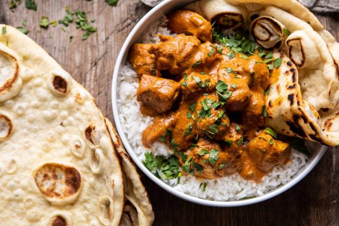 overhead photo of Super Simple Coconut Chicken Tikka Masala in bowl with rice