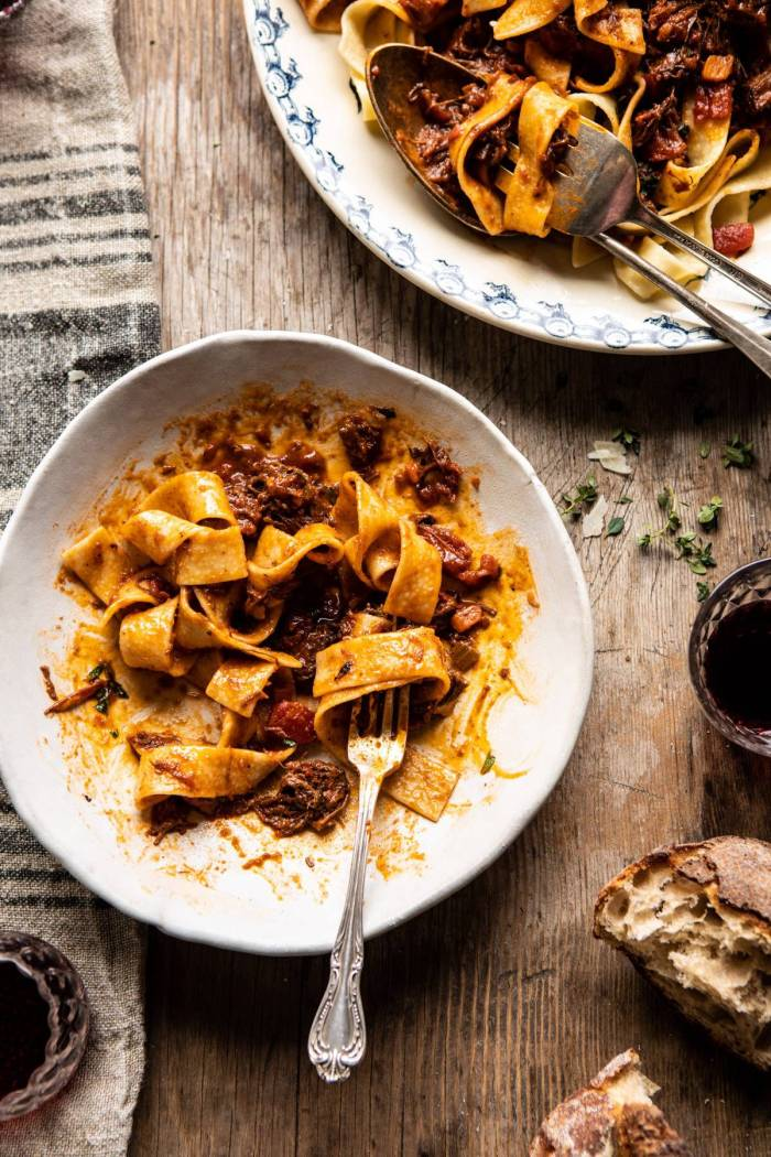 overhead photo of Slow Cooker Red Wine Sunday Ragu Pasta half eaten with fork in bowl