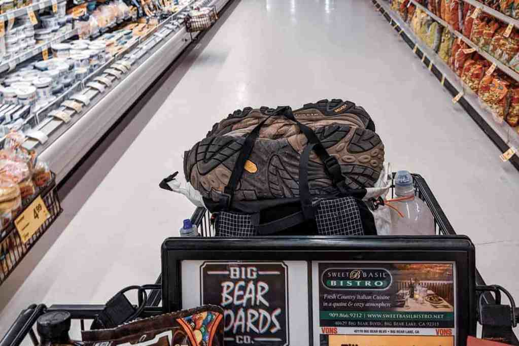 Hiker shopping cart in a supermarket