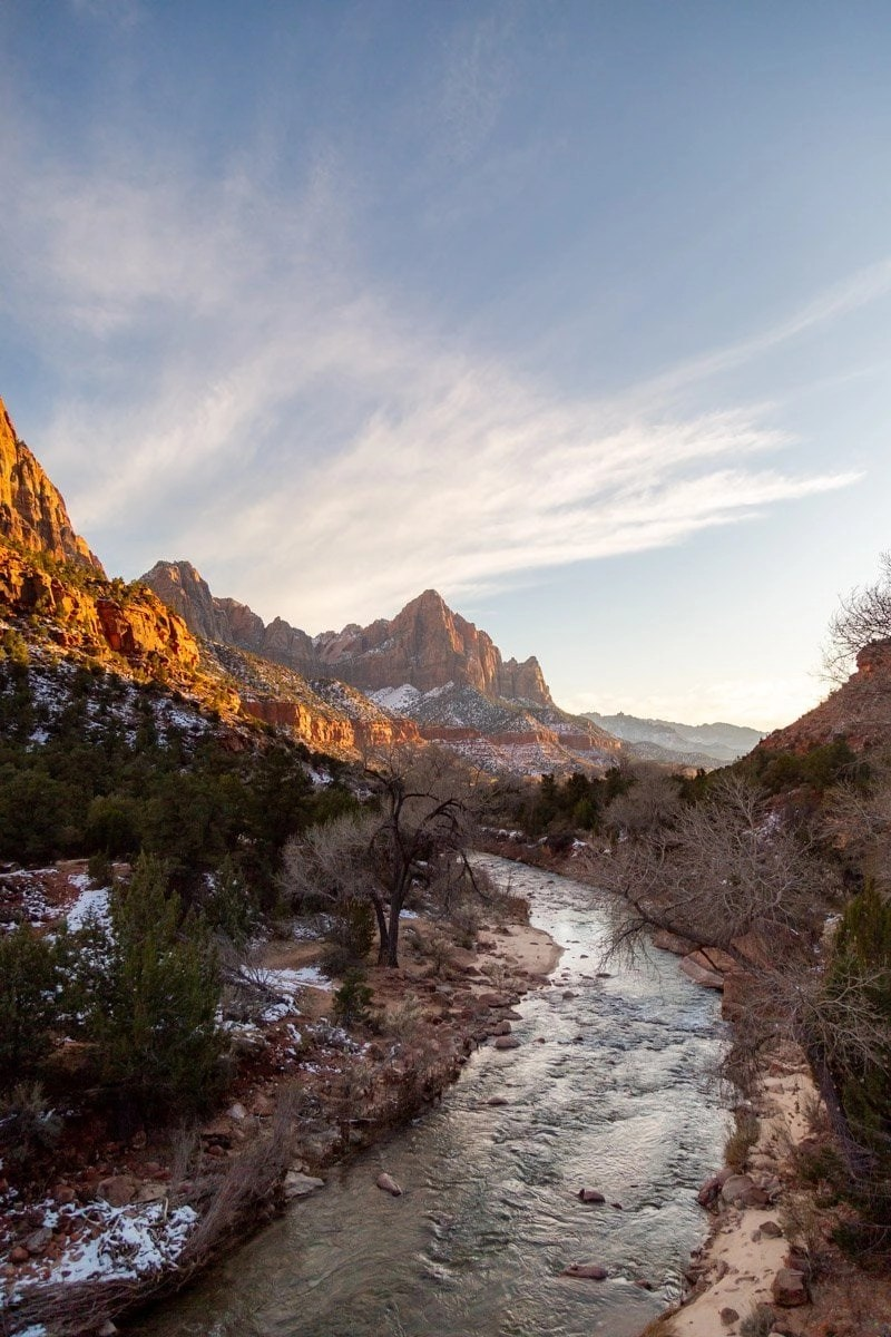 the virgin river through zion national park leading to the grand view of watchmen tower at sunset