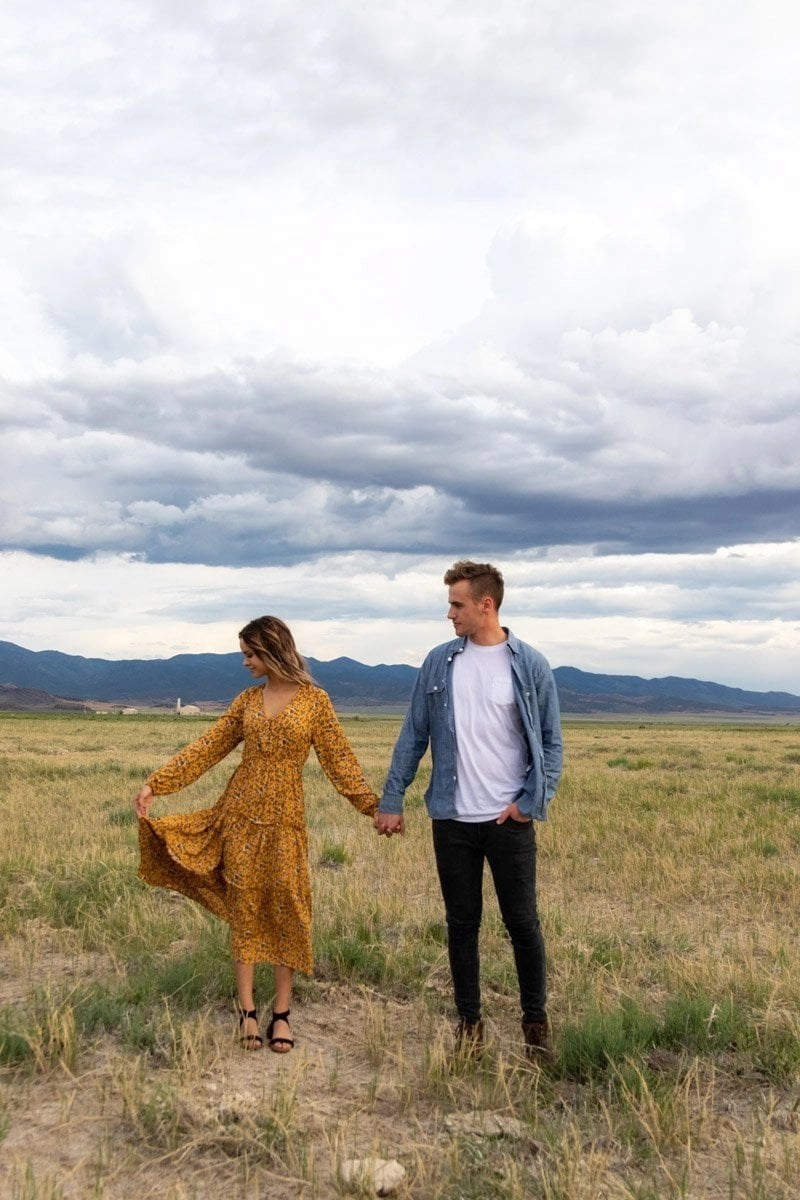 utah couple in a meadow