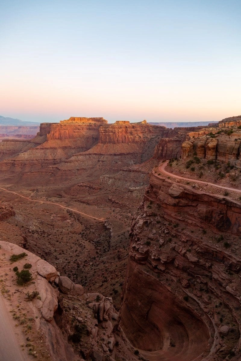 elope in canyonlands national park at sunset for stunning views like these with soft colors