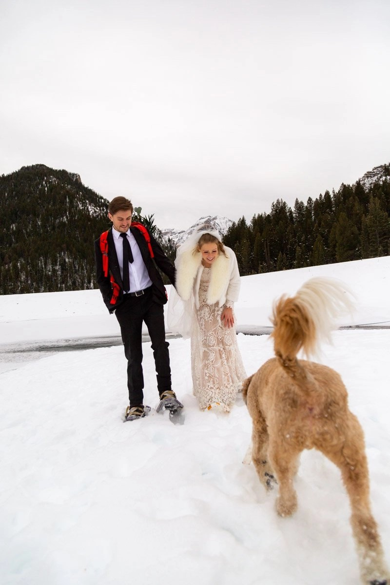 winter elopement in the wasatch full of adventures and snowshoeing with a dog