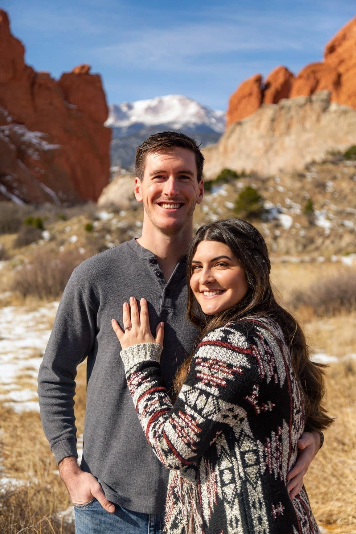 Classic engagement shot among the beautiful backdrop of sanstone towers in Garden of the Gods park in Colorado