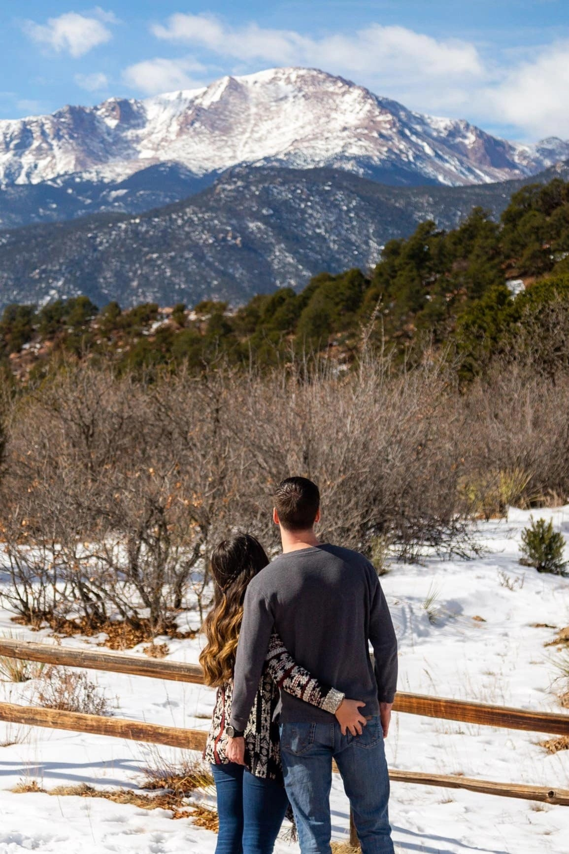 butt grabs while starring off at Pikes Peak in Garden of the Gods park. Adventure sessions are funw hen you get out and explore what nature has to offer and have a little fun along the way