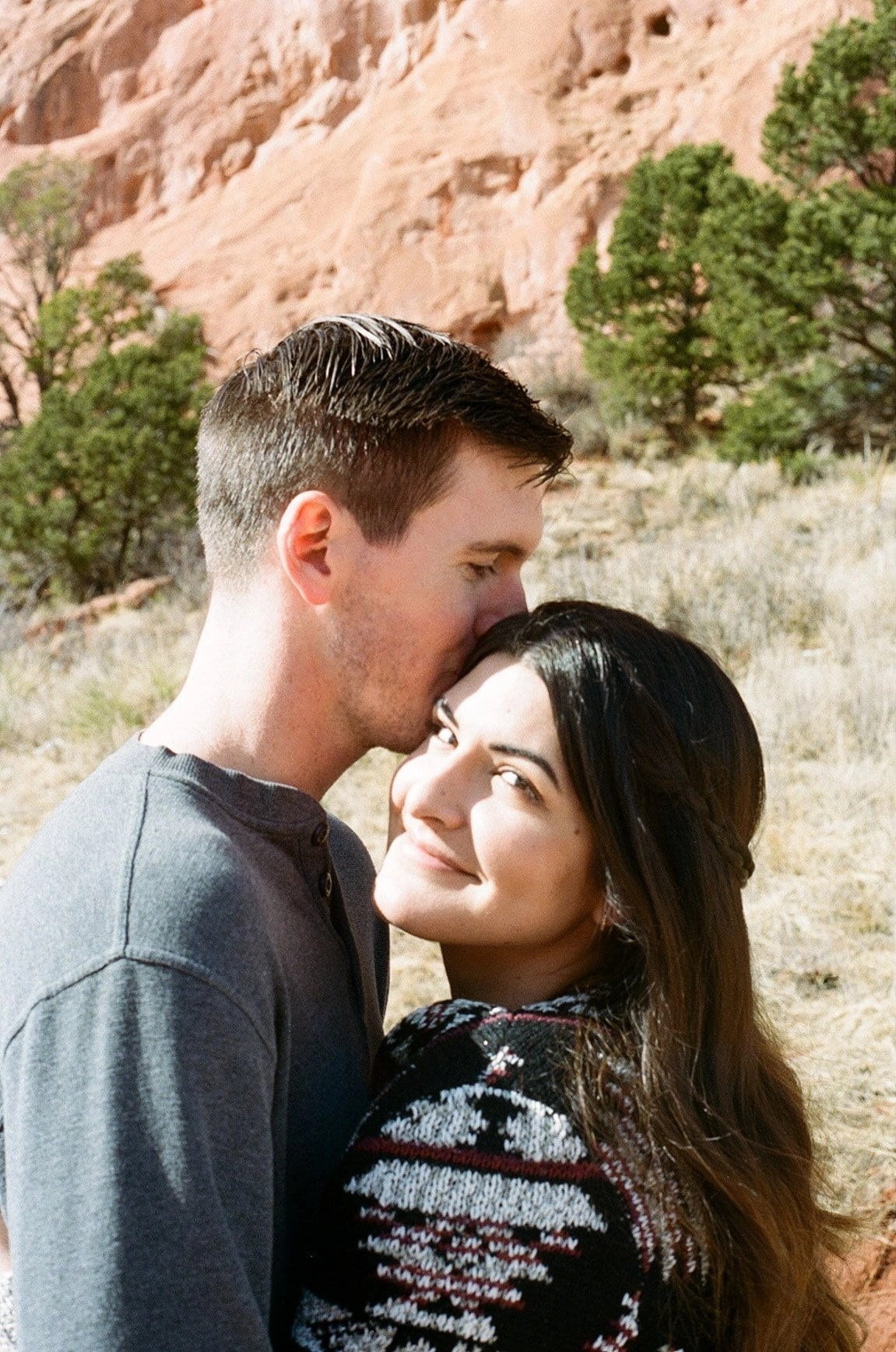 Garden of the Gods on film. A couple has their engagement session in Colorado among the iconic red rocks in Colorado's most photographed place
