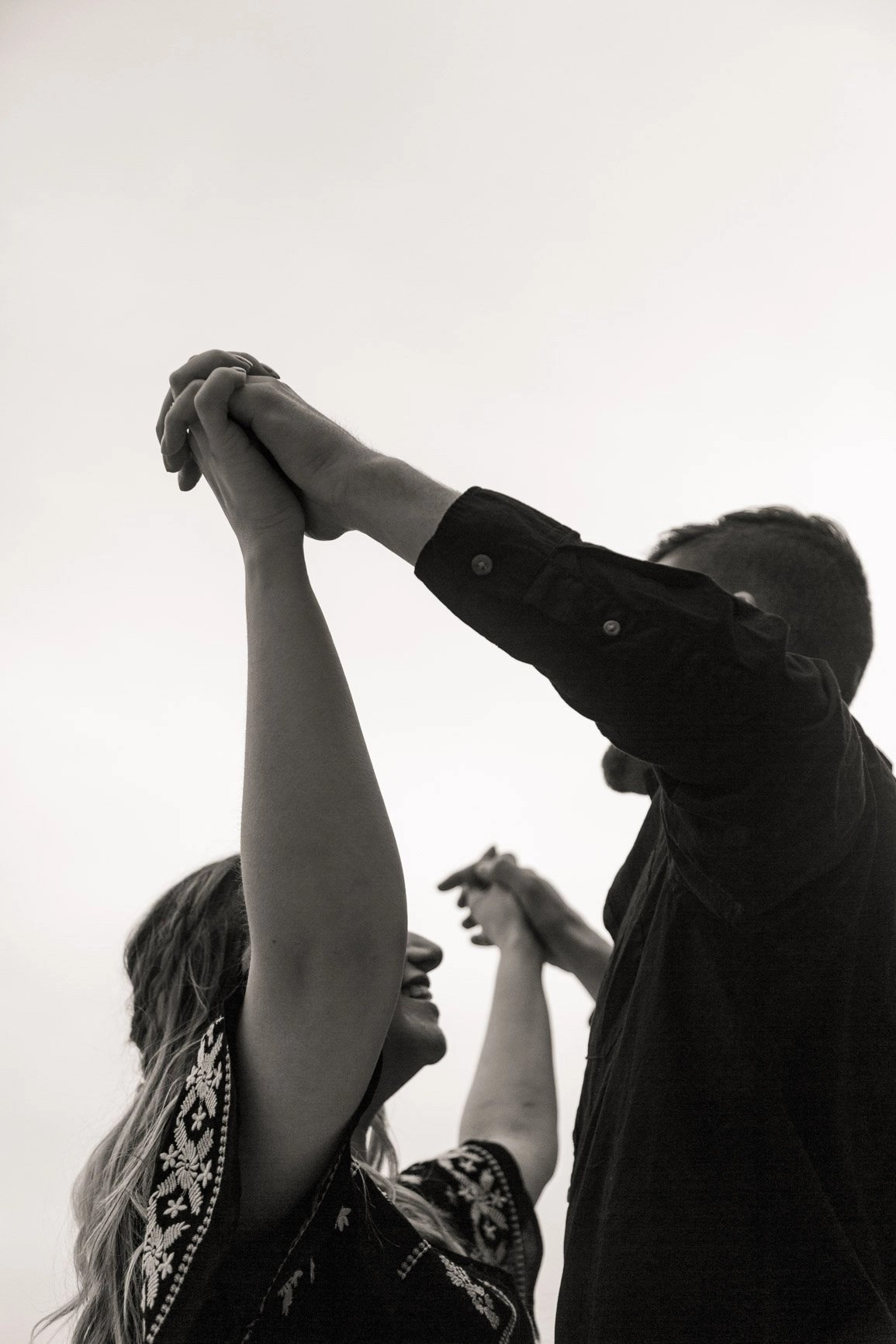 lovers holding hands during their adventure in moab