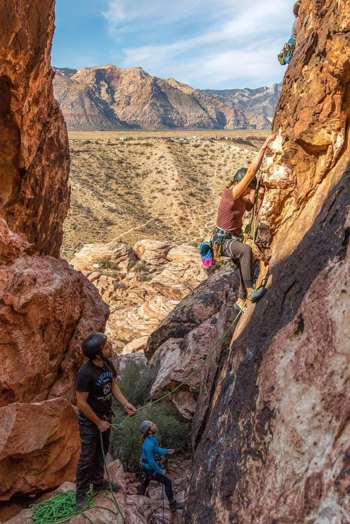 couple climbing in red rock canyon nevada