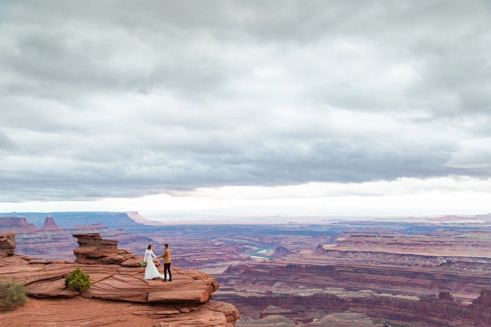 a couple dances during their elopement at at dead horse point state park in utah