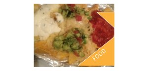 Mountain of nachos with cheese, salsa and guacamole