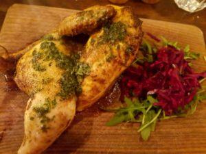 Half chicken with herbs and garlic