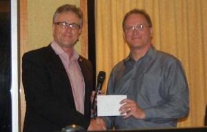 Chris Edwards presents cheque to Glenn Keys