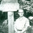 Ronald Perry in front of Camp Kawabi sign
