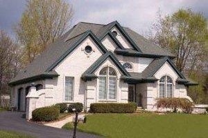 gabled-asphalt-roofs-over-ston-and-vinyl-cladding-300x200
