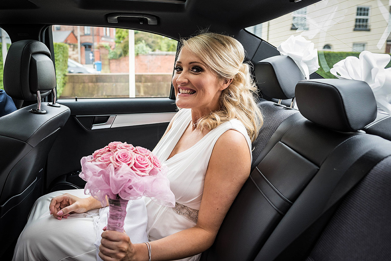 happy but nervous bride arrives at knowsley registry office