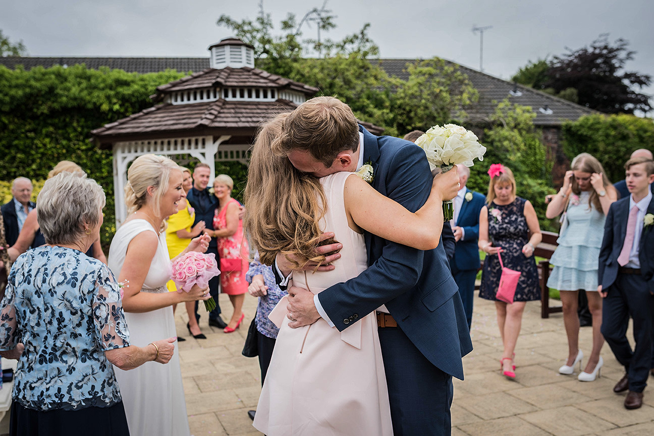 groom hugs his sister after civil ceremony