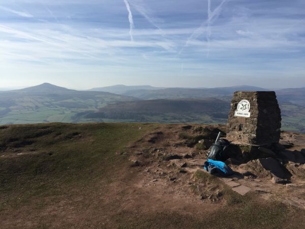 Trig Point of The summit of Ysgyryd Fawr with Sugar Loaf summit in distance