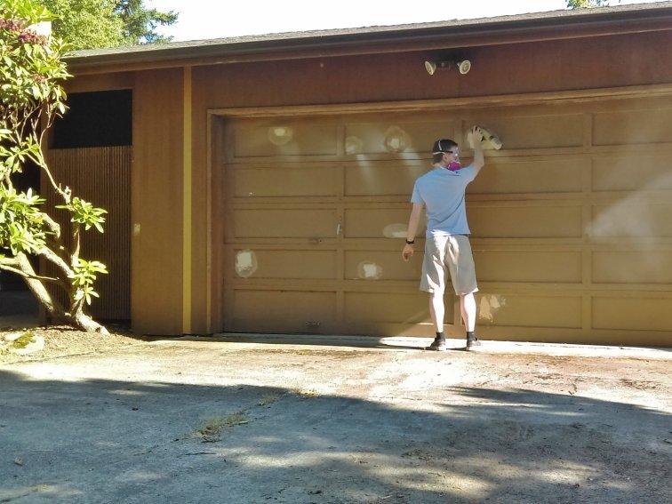 Filling in garage door holes with wood filler