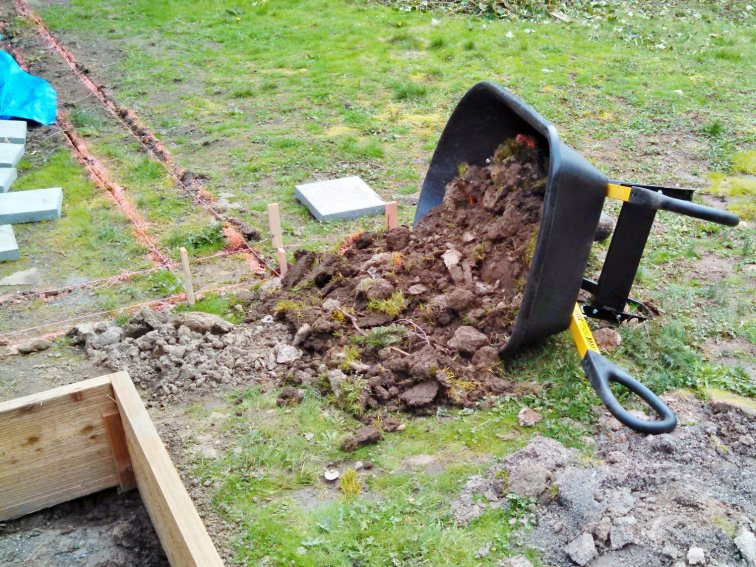 Digging a trench for paver steps in garden