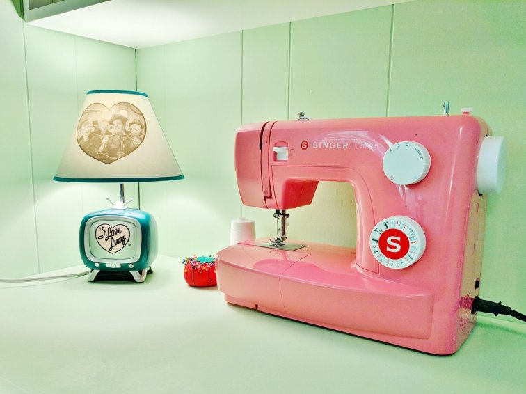 Retro I Love Lucy lamp with pink sewing machine in craft room
