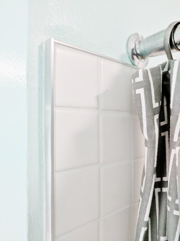 Modern Shower Tile for a Mid-Century Bathroom: Add tile edging