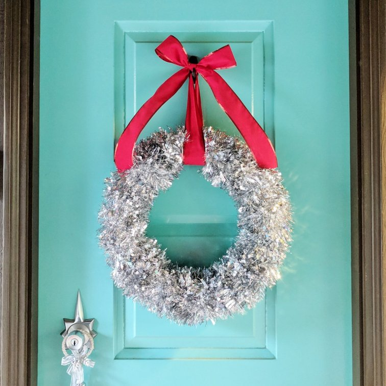 Adorn the front door with a tinsel wreath