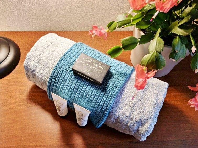 Roll towels and display toiletries for your houseguests