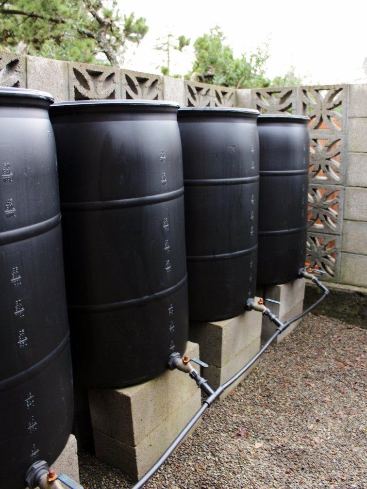 Rain barrel system on concrete blocks