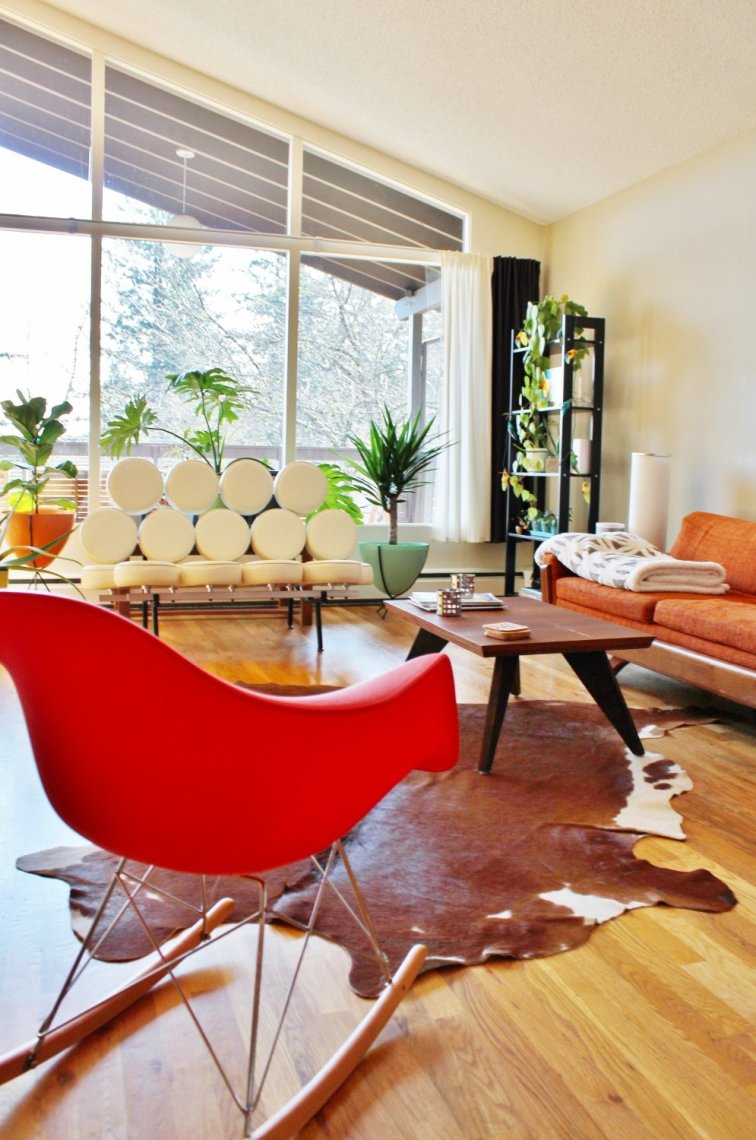Place an Eames rocking chair in the middle of a living room to showcase the design