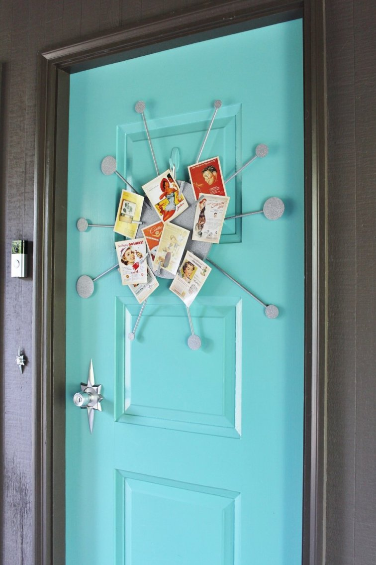 Turquoise mid-century modern front door with retro wreath