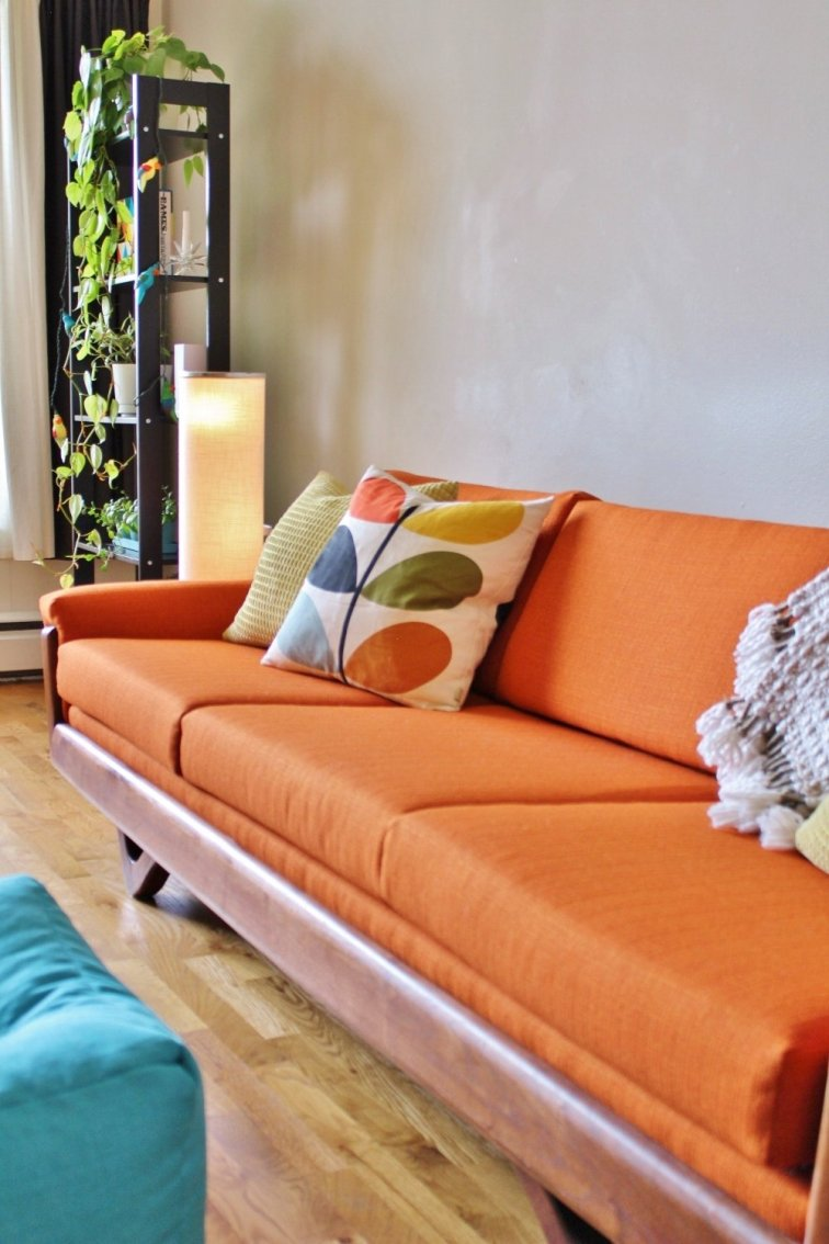 Orange mid-century modern sofa after reupholstery