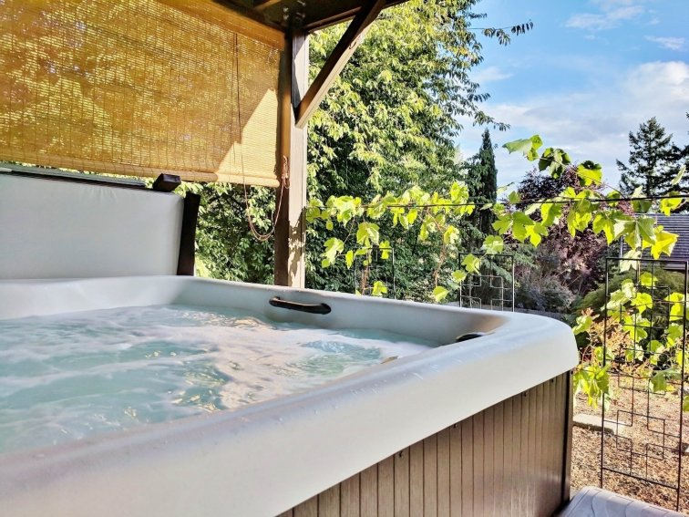Hang a privacy shade around your hot tub