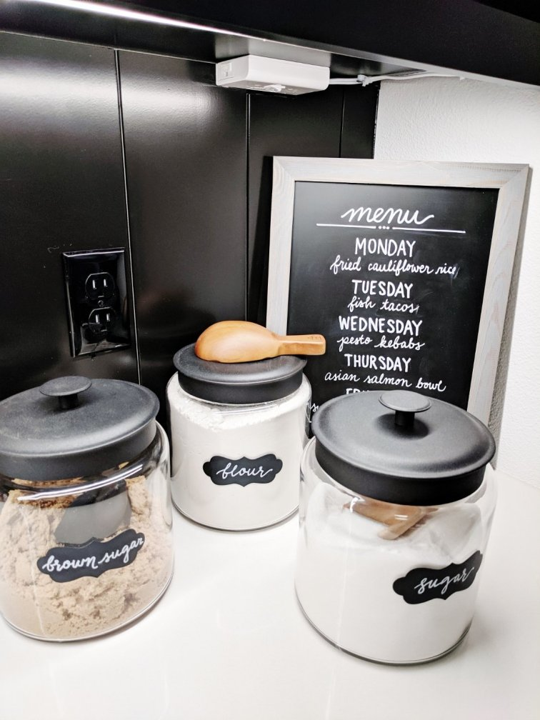Kitchen counter with chalkboard menu and pretty canisters