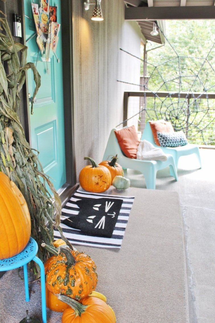 Mid-century modern front porch decorated for Halloween