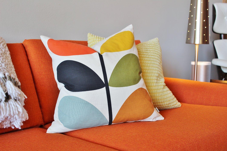 5 Best Throw Pillow Styles for a Mod Orange Sofa