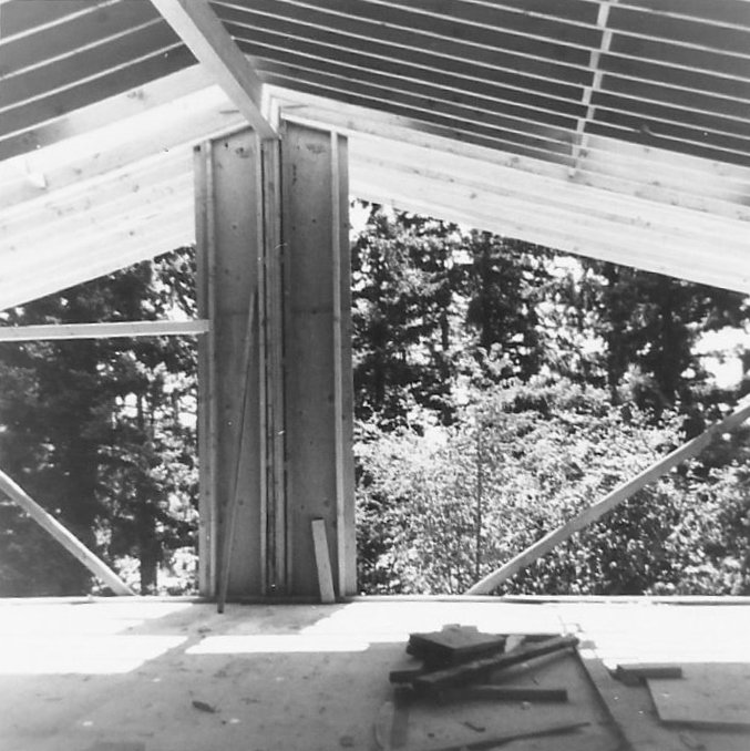 Mid-century house being built, back wall open