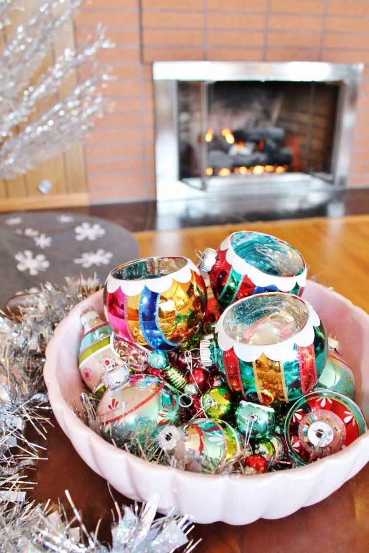 Vintage style ornaments displayed in an antique ceramic bowl