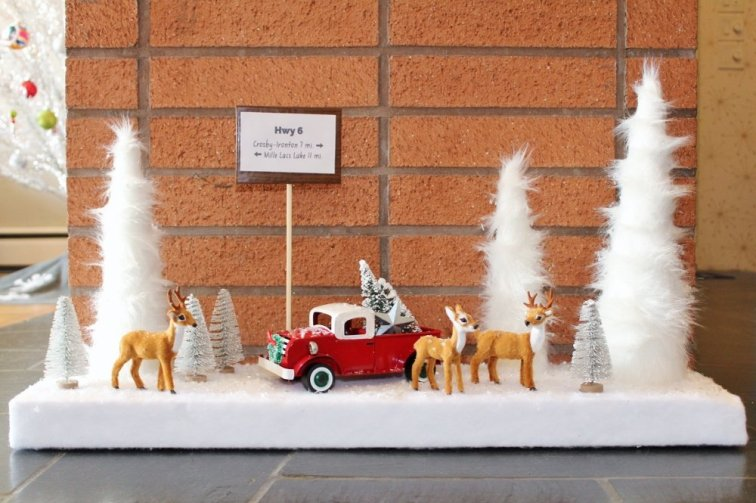 Fur cone tree Christmas decor scene with deer figurines and red truck