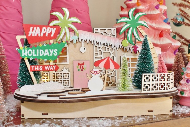 Mid-century modern Christmas village house from World Market with Happy Holidays sign