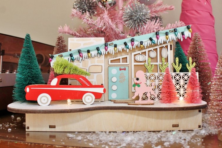 Mid-century modern Christmas house display with bottle brush trees from World Market