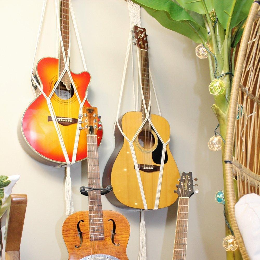 Macrame guitar holders hanging on wall in tiki bar