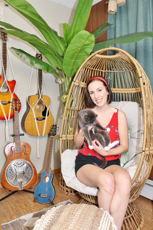 Tiki bar lounge chair with guitars hanging on the wall