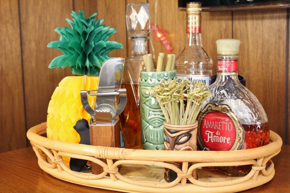 Tiki bar bamboo tray with liquor and tiki mugs