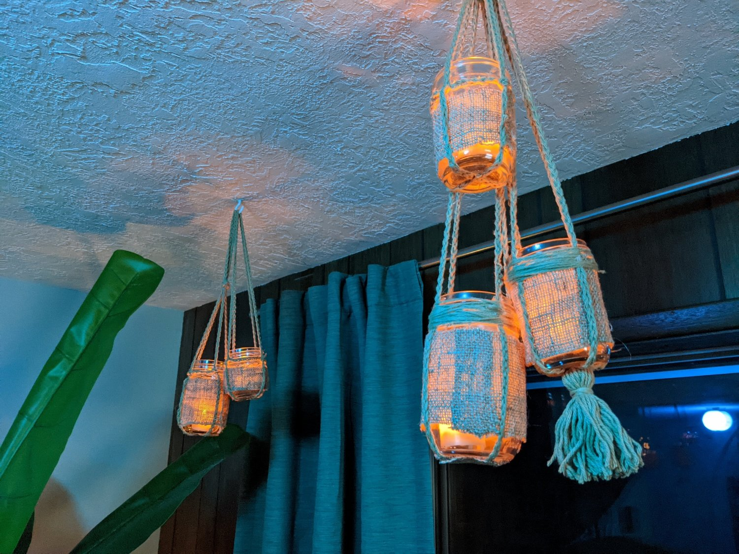 Handmade tiki bar lights in glass jars with LED candles and crocheted hangers