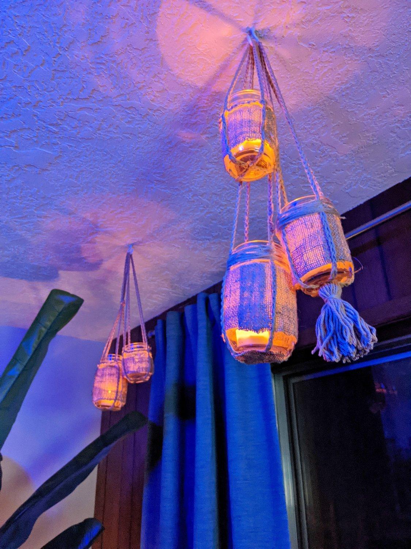 Glowing lanterns under color-changing tiki bar lighting