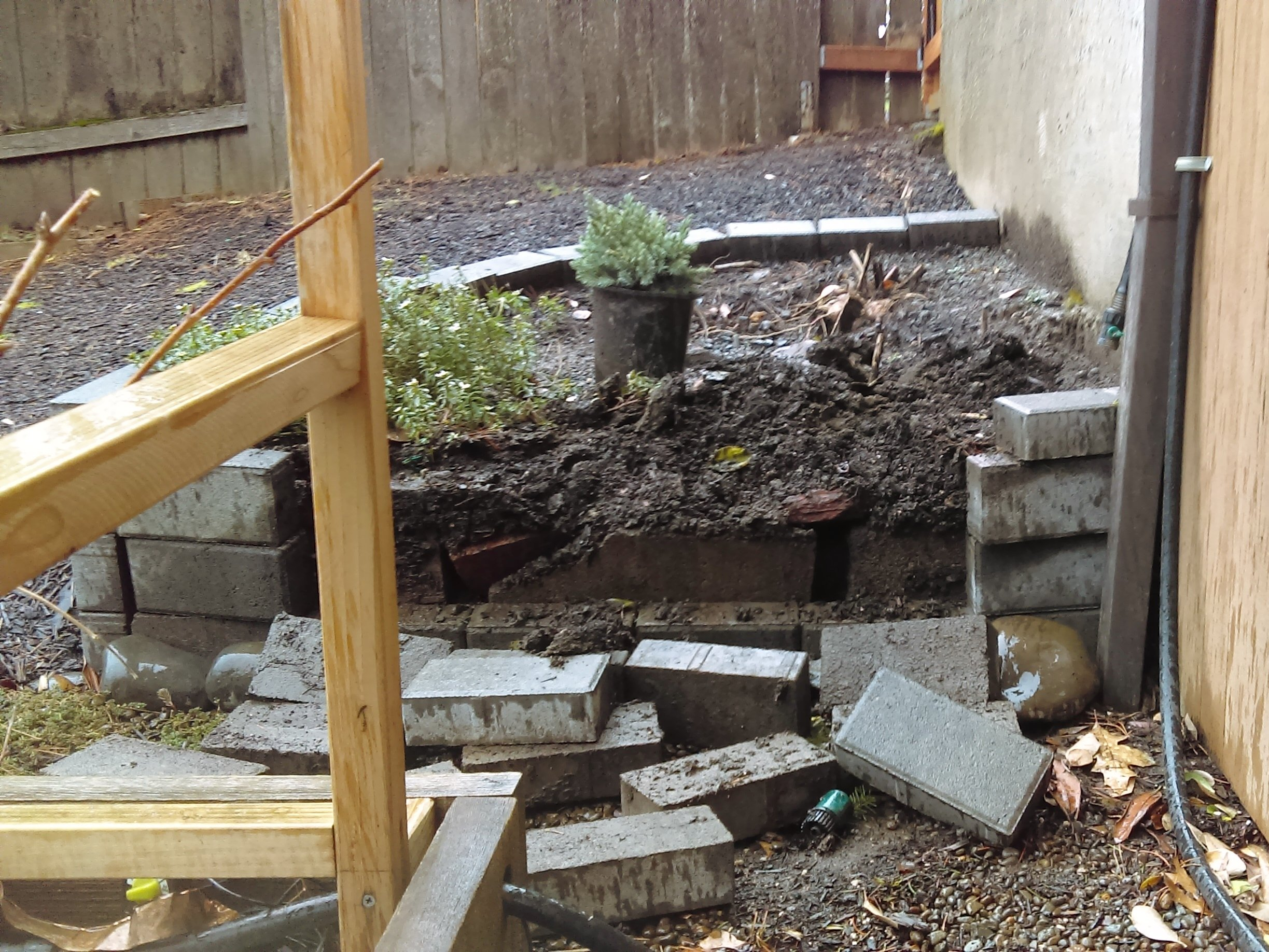 Falling bricks in loosely stacked planter