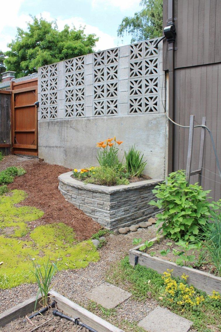 Planter made with modern retaining wall blocks in mid-century backyard