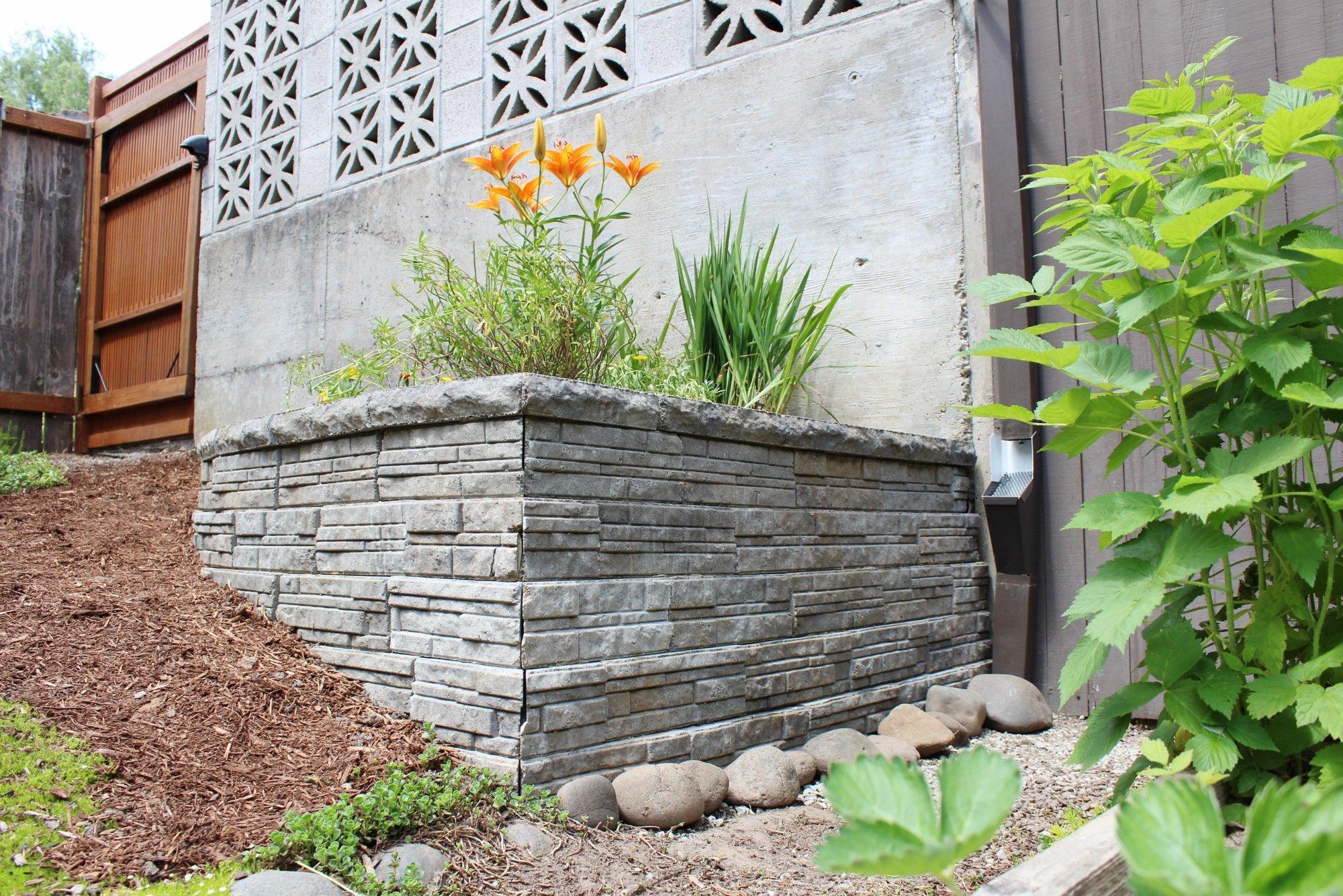 Modern retaining wall blocks for mid-century planter in backyard